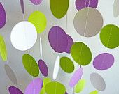 This beautiful garland is 10 feet long and made from lightweight Purple, Lime Green and White cardstock. It is sewn with strong white thread, and Ive left plenty of extra thread on each end to assist in hanging the garland, but you can always snip it off and hang with tape or thumb tacks, or just drape across a table, furniture, fence, etc. It would also look great cut into lengths and hung from the ceiling!    Material: cardstock  Length: One strand, 10 long  Circle Sizes: Choose 1.5, 1.75…
