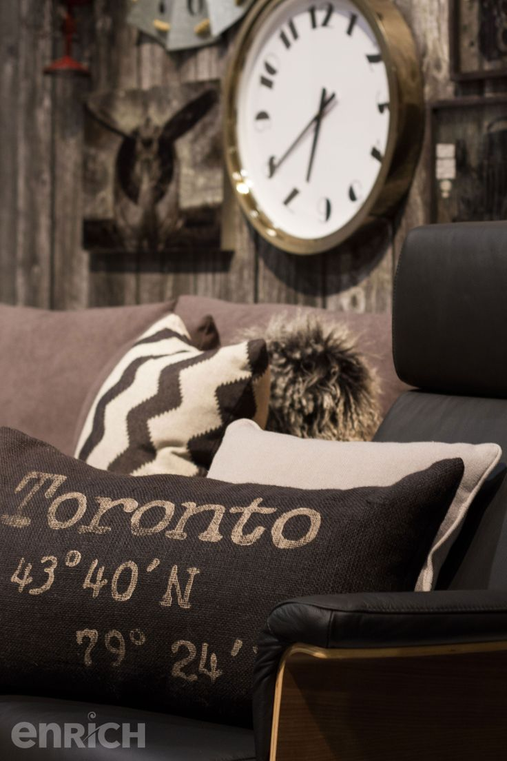 With a neutral pallet and quirky accents, this warm living space is the perfect man cave, or rustic lounge pad for any gal with a masculine side! Designed by Glen Peloso & Jamie Alexander. #GTAHomeShow #HomeDecor #InteriorDesign #Toronto #EnrichYourLife