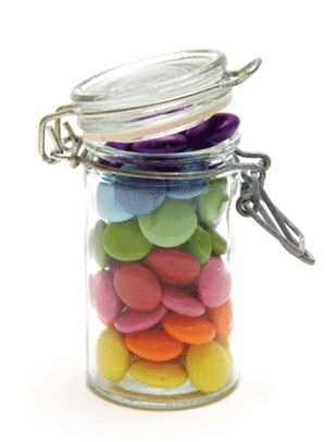 Party favours: Little jars with Smarties layered into rainbows suit the theme perfectly.