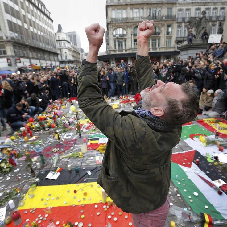 A man reacts at a street memorial following Tuesday's bomb attacks in #Brussels, March 23, 2016.  CREDIT: Francois Lenoir/Reuters SEE MORE at ABCNews.com/photos #abc