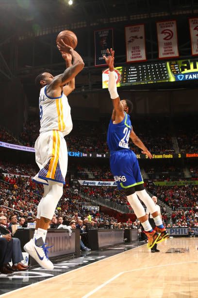 Andre Iguodala of the Golden State Warriors shoots the ball against the Golden State Warriors on March 6 2017 at Philips Arena in Atlanta Georgia...