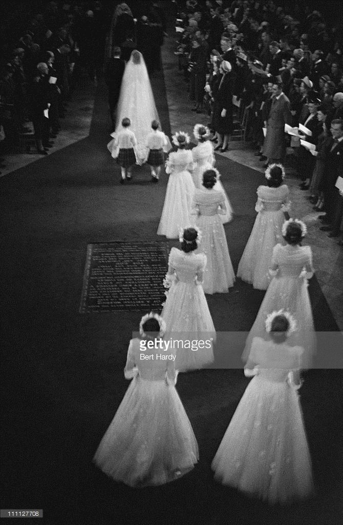 Princess Elizabeth (later Queen Elizabeth II) and Prince Philip make their way down the aisle of Westminster Abbey, London, on their wedding day, 20th November 1947. Original Publication: Picture Post - 4438 - Royal Wedding - pub. 1947