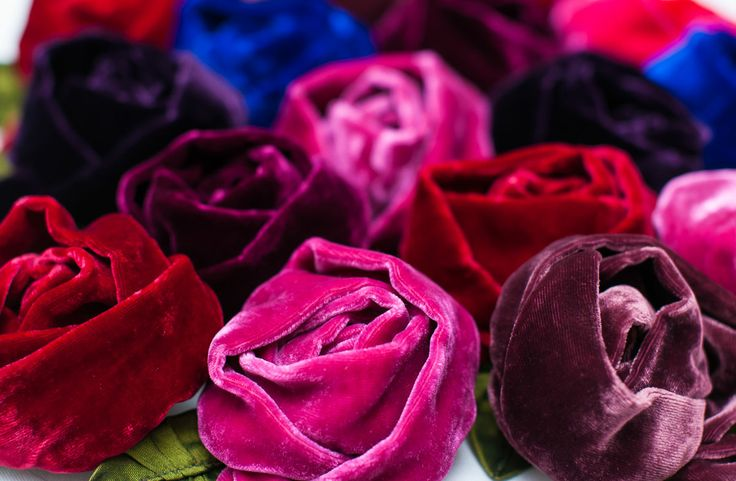 These are beautifully handmade brooches by NZ designer Tamsin Cooper with a large layered rose and small side rosebud made from luxurious velvet petals and 100% silk taffeta leaves. This best selling velvet rose brooch will be admired every time you wear it as a fabulous and glamorous feature to brighten up any outfit. Swap the brooch between different jackets or dresses as needed. Perfect for Mothers Day!