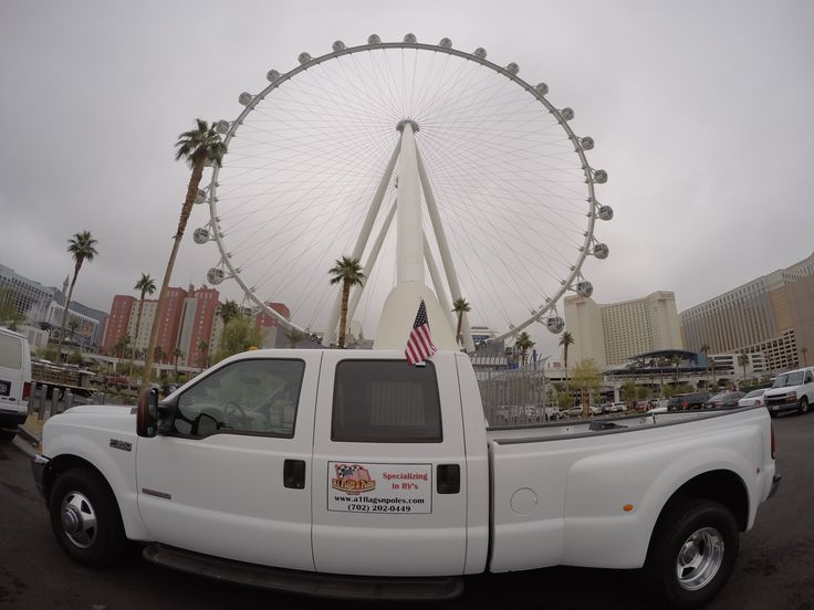Car Flags are dwarfed by the High Roller in Las Vegas Nevada   #gifts #unlv #rv #Bikers #Sturgis2014 #harleydavidson #motorcycles #harley #buffalochip #NASCAR #flags #flagpoles #rvflags #rvflagpoles #rvs #rving #lasvegas #a1flagsnpoles #glamis #camping #tailgating #Pirate4x4 #pirate #rv #veterans #military #army #airforce #marines #navy  http://www.a1flagsnpoles.com/car_flags