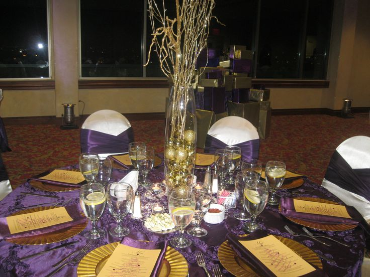 Holiday party decor gold and purple centerpiece