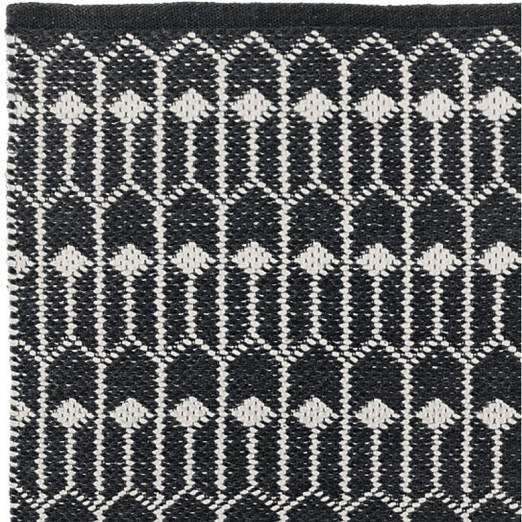 TULIP in BLACK/ECRU is made of 100% cotton. Perfect for indoor. Available in 55x120cm   70x200cm   140x200cm   200x300cm