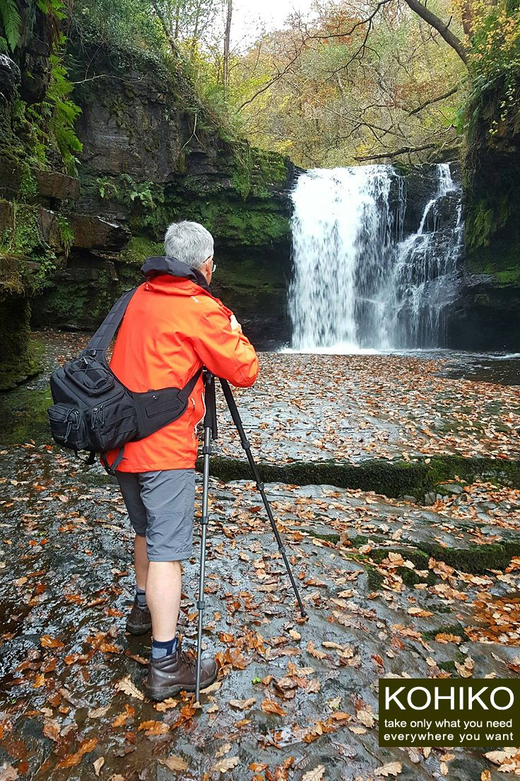 English travel photographer Andreas Jones (http://bit.ly/2eedDKh) with KOHIKO™ camera backpack on a photo set. The Neath river waterfall, South Wales, UK.