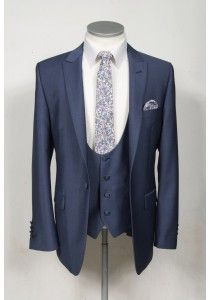 Steel blue wool & mohair slim fit lounge suit made to measure wedding suit. An Italian light weight petrol blue wool & mohair made to measure  suit in a 1 button style jacket. Styled with a slim peak lapel & side vents Teamed with a matching lower cut scoop neck waistcoat and slim fit trousers A choice of linings to and trims are available 2 piece made to measure  £595 3 piece made to measure £695 #wedding #groom #suit #weddingsuit #slimfit #anthonyformalwear
