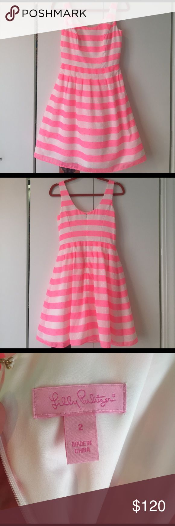 Lilly Pulitzer Striped Dress. Unworn Stunning Lilly striped dress. Bright pink and white stripes with fun for texture detail. Never worn. Perfect condition. Soft stacked lining for fun volume. Perfect Easter or spring dress. Super high quality gem. Lilly Pulitzer Dresses
