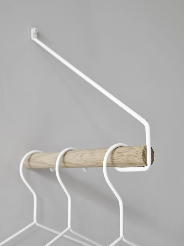 This clothes rack is perfect for displaying the favourite pieces that you do not want to hide away in the closet. Made from oak and metal, this rack fits 2-3 hangers and can be placed anywhere in the room. Two racks can make a nice support for a shelf. Size: 22 cm long.