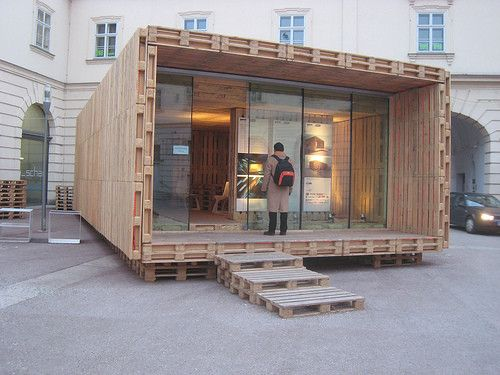 Home constructed from wood shipping pallets.  Great glass front wall.
