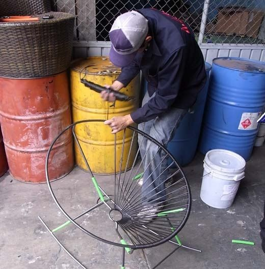 How It's Made: The Acapulco Chair. Here you can see a gentleman weaving an Acapulco chair by hand.