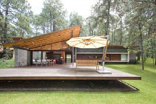 Fachada de casa moderna combinada con fachada de casa de for Casas modernas de campo