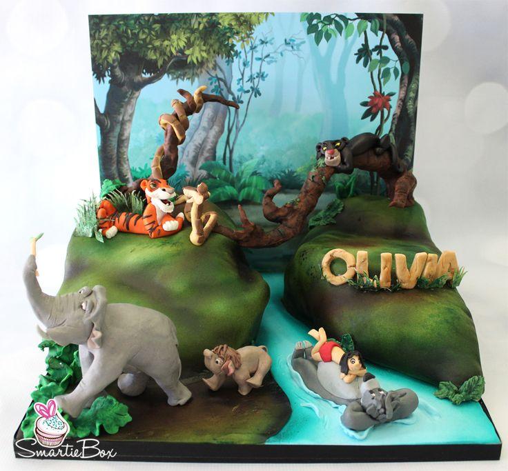 Jungle Book cake. All figurines are made from modelling chocolate, Mowgli, Baloo, Bagheera, Colonel Hathi, baby elephant, Shere Khan and Kaa - SmartieBox Cake Studio