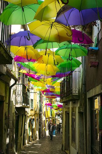 An umbrella ceiling? How cool is that? #Lisbon #Alfama
