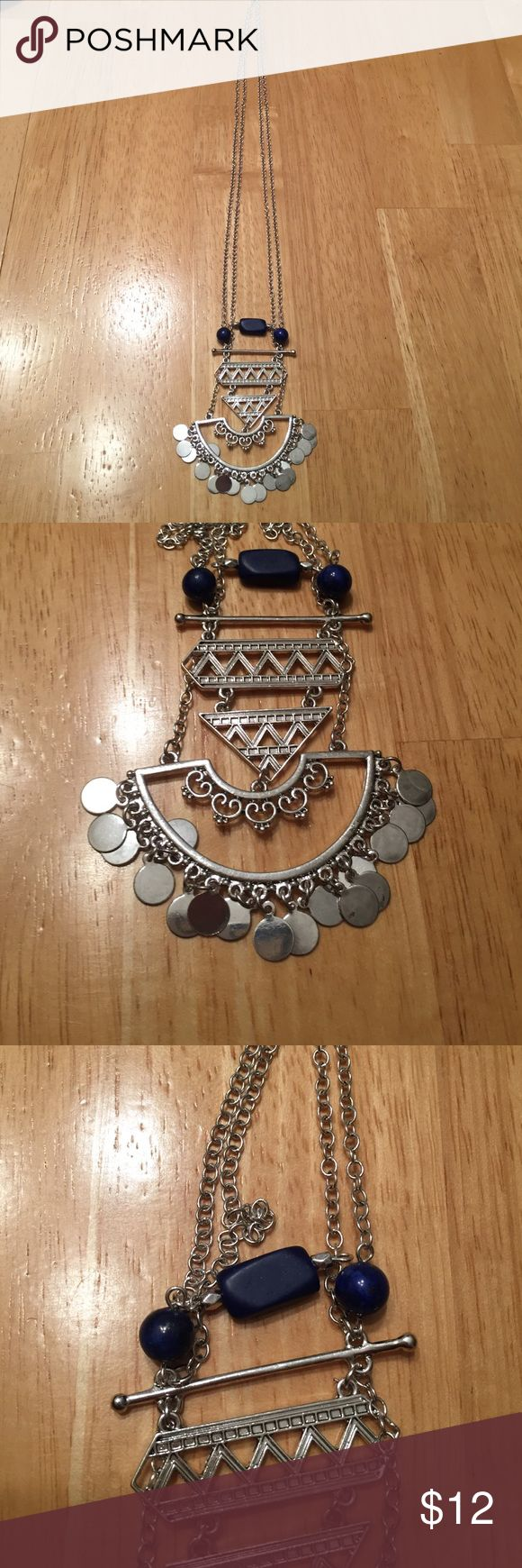 Brand New silver long chain w/ aztec pendant Brand New silver long chain w/ aztec pendant, 3 blue beads on top. Silver-tone finish, long thin chain, medallion pendant, lobster clasp Jewelry Necklaces