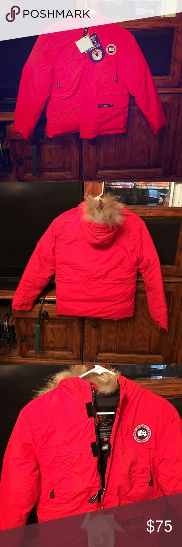 Downmark Youth Size Large Down Coat NWT This coat is brand new with tags.  It is red with faux fur around the hood.  It is top quality. Made in Canada and filled Canadian goose feathers.  It has been treated with Teflon fabric Protector so water just rolls off and stains just wipe away. Downmark Jackets & Coats