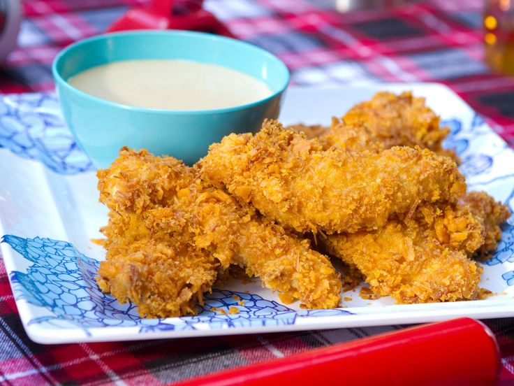 These Chicken Tenders are crusted with ground up cheese crackers! Baked Chicken Tenders - Trisha Yearwood
