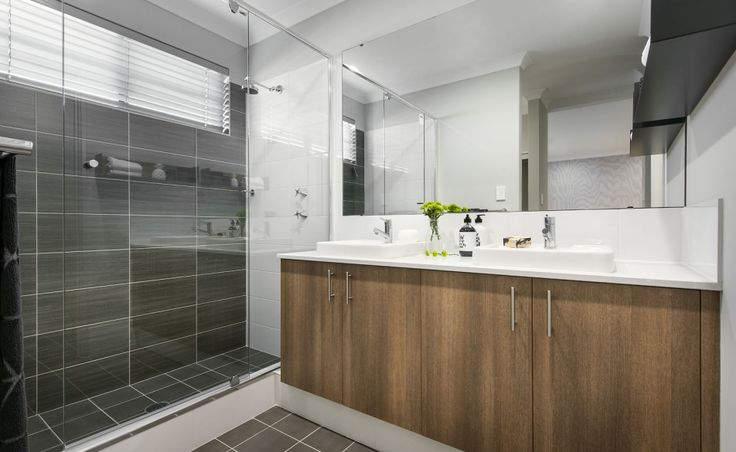 Ensuite with twin vanity basins, double sized shower and seperate WC