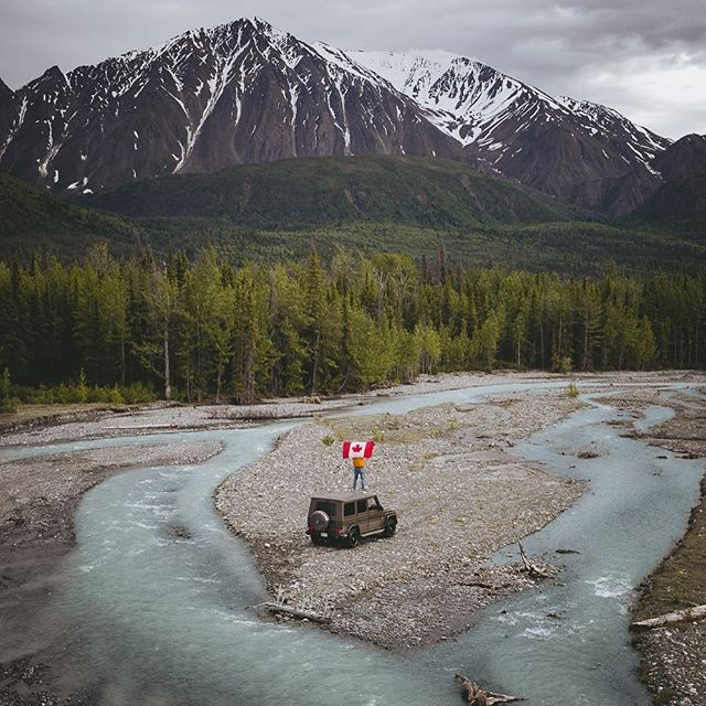 """Happy Canada Day 🇨🇦🎉 to the country of wilderness and endless adventures. """"Thanks @explorecanada for giving us the space to live our dreams. Crossing blue watered rivers and diving deep into the Canadian wilderness. Can't remember a place life felt so good."""" Quote and photo by @pangea. #canada150 #ExploreCanada #travelyukon #gclass #mercedesbenz #neverstopexploring #thenorthface #canada #🇨🇦 #canadaday #mountain #travel"""