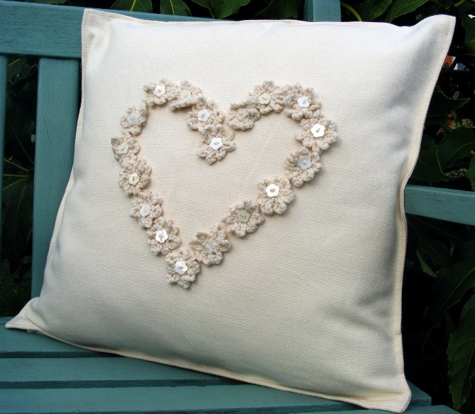 Cushion with crochet heart