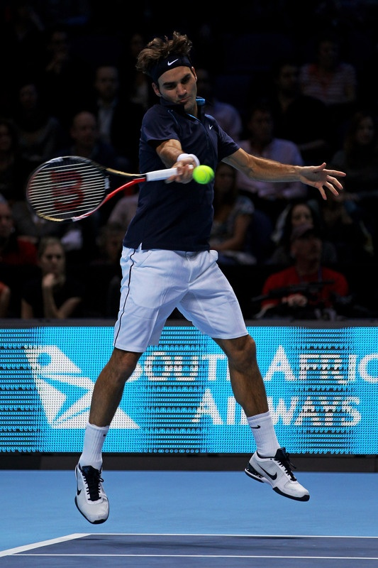 LONDON, ENGLAND - NOVEMBER 27: Roger Federer of Switzerland hits a forehand during the men's final singles match against Jo-Wilfried Tsonga of France during the Barclays ATP World Tour Finals at the O2 Arena on November 27, 2011 in London, England. (Photo by Clive Brunskill/Getty Images)