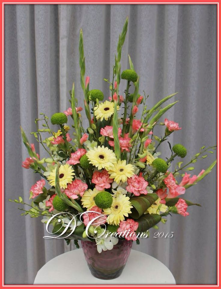 Gladiolus, gerberas, carnations and white orchids