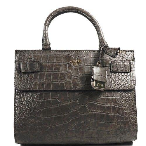 Un sac au look sauvagement tendance signé Guess. Aspect croco et finitions soignées cette ligne de sacs et accessoires est un vrai bijou !