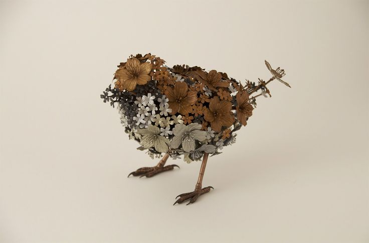 Artist Taiichiro Yoshida forms the delicate wings of birds and fluffy fur of mammals from a variety of sculpted metal flowers of bronze, copper, or silver. Decorative hot metalworking in Japan is considered an ancient technique, beginning sometime in the 2-3rd century BC. Yoshida achieves the fragil