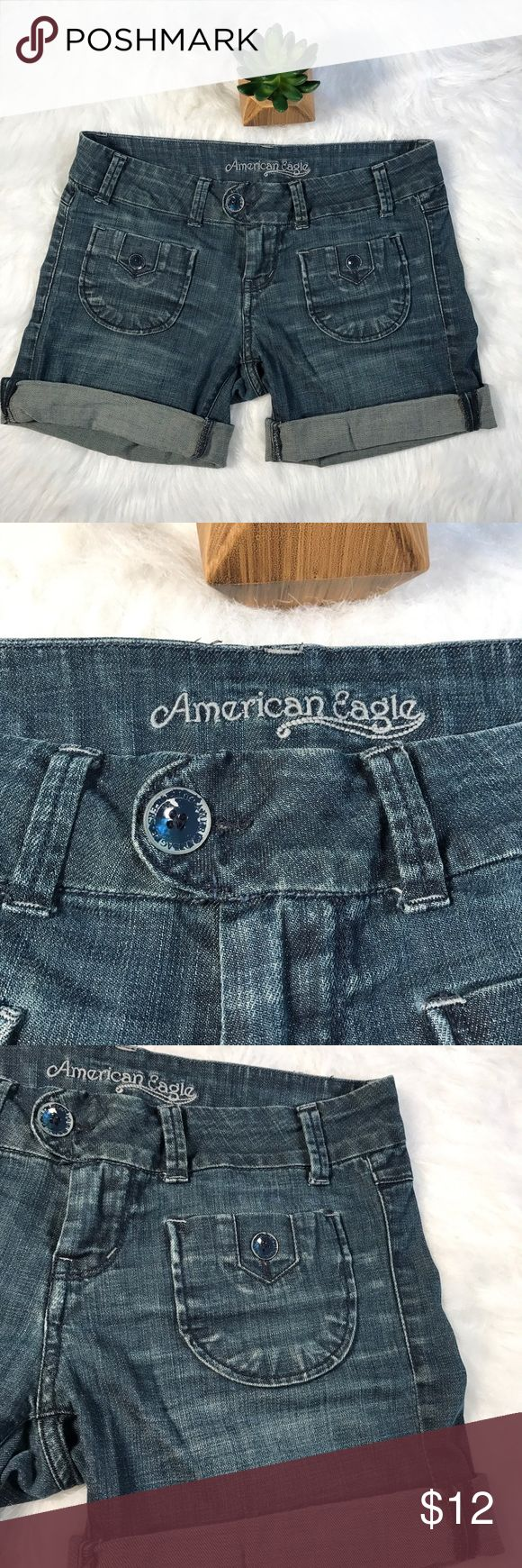 American Eagle trouser style Bermuda jean shorts Classic trouser style Bermuda length jean shorts from American Eagle Outfitters. Size 4 with some stretch. Can be worn at Bermuda length or cuffed shorter. Functional slit pockets on back and small buttoned pockets on front. Well loved but no flaws except a little paint peeling off of buttons. (Close up) American Eagle Outfitters Shorts Jean Shorts