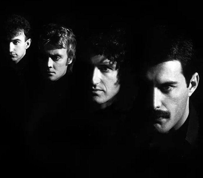 Queen- John Deacon, Roger Taylor, Brian May, and Freddie Mercury