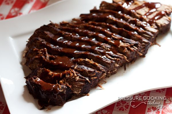 Smokey Beef Brisket in the Pressure Cooker - What's great about this recipe is the smokey flavor the brisket gets from the liquid marinade. The brisket marinates overnight, but then only has a 1 hour cook time in the pressure cooker, compare with 6 – 8 hours in the oven.