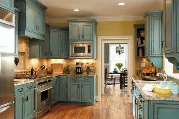 Annie Sloan chalk paint in duck egg blue with dark wax. This is what I want to do with my new kitchen cabinets!