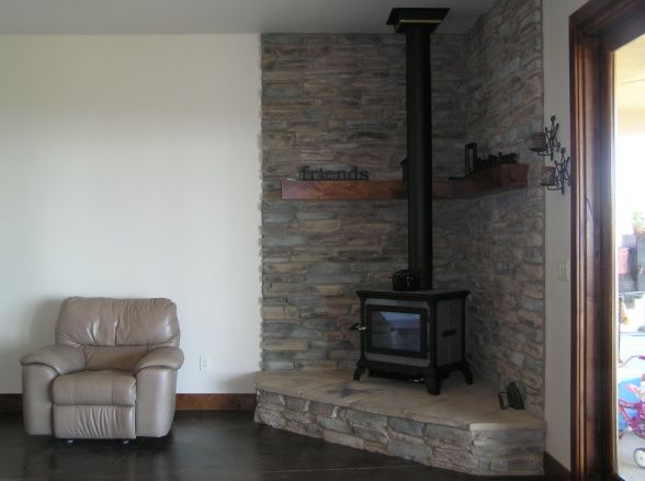 Rustic Wood-Burning Stove Ideas | Rustic Great Room, Acid stain concrete floor, wood burning stove, and ...