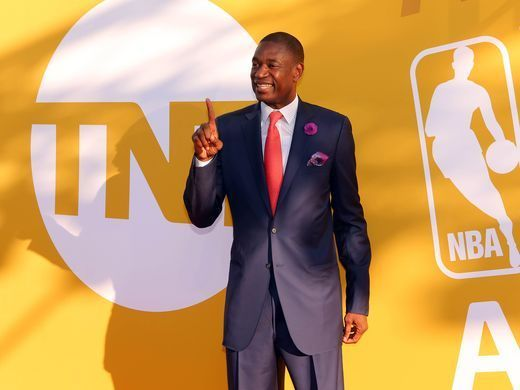 Dikembe Mutombo poses for photos on the red carpet