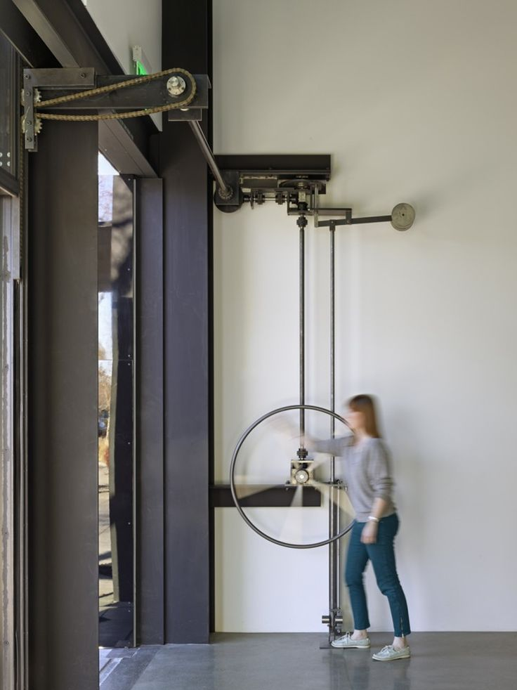 When the ubiquitous becomes elegant. Door wheel to operate facade 242 State Street / Tom Kundig - Olson Kundig Architects