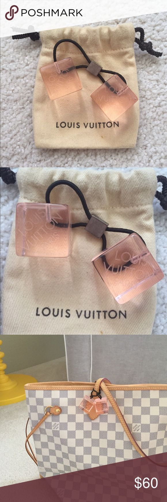 Louis Vuitton Clear Pink Hair Cubes 100% Authentic Louis Vuitton Hair Cubes. 1 hair cube only. Was originally sold as a pair. Elastic still in good condition, not stretched out. Cute in hair, works as a bag charm too!! No trades. Will include the clear zippered bag it originally came in. Sorry does not come with the dust bag that it's pictured with. Louis Vuitton Accessories