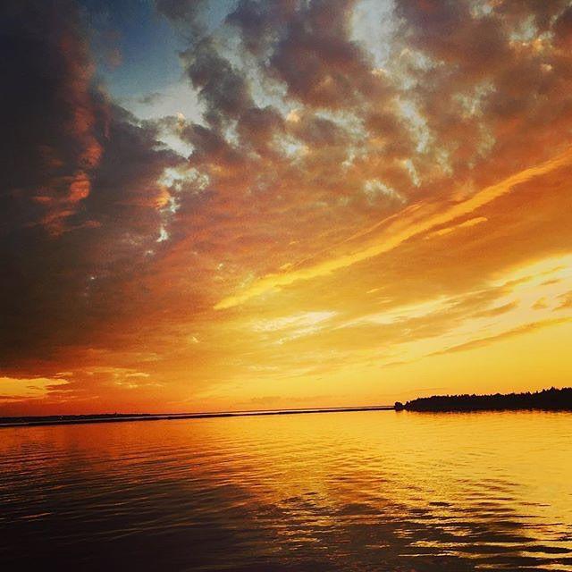Witness stunning summer sunsets in New Brunswick like this one over Caraquet. #ExploreNB // Doux soleil de mer à Caraquet. #Acadie Photo : @tirebouchongriffin / Instagram
