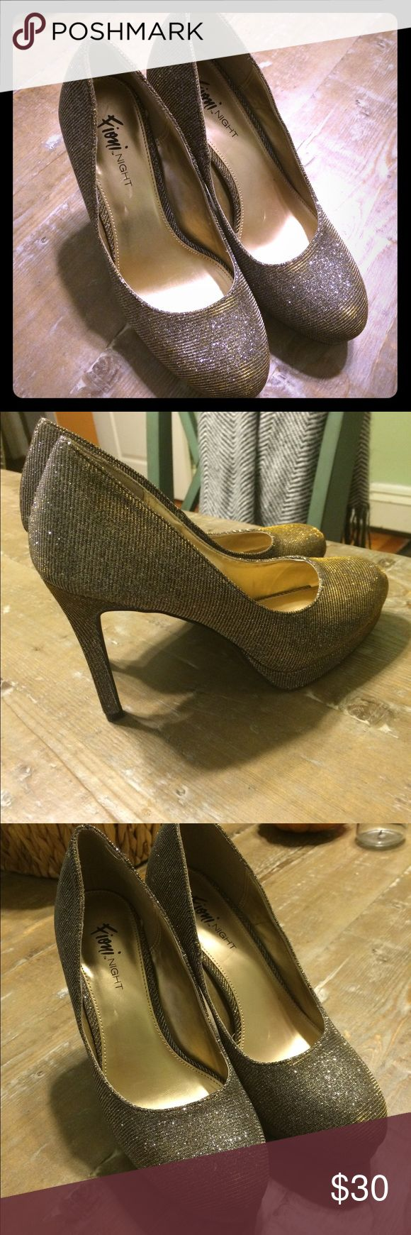 Shimmer gold stilettos I call these my News Years Eve shoes! Great for a classy night out. Walkable heel, very comfortable. I wore one night at New Years last year, so practically new! FIONI Clothing Shoes Heels