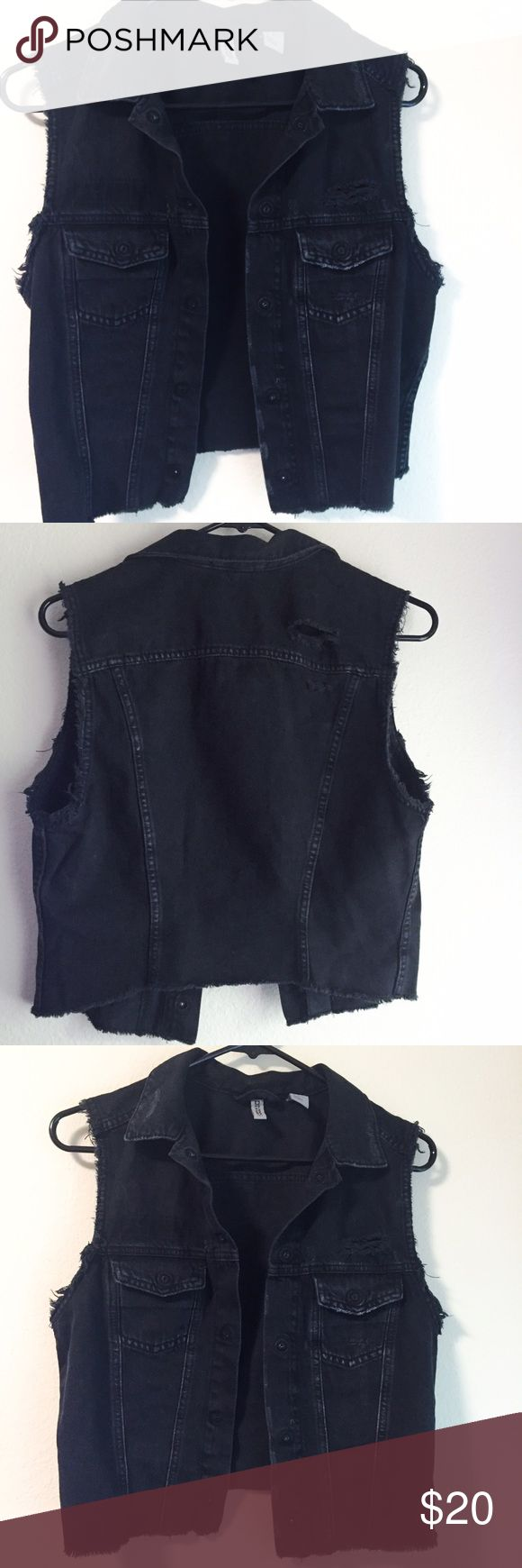 Black Denim Vest from H&M Black denim vest from H&M's divided. Falls to your natural waist and is a size 12(L) it came distressed with a couple artfully places holes. It is open faced (no buttons) and is a perfect layering piece. Only worn out a couple of times. #grunge #Coachella #punk #festival #goth #metal H&M Jackets & Coats Vests