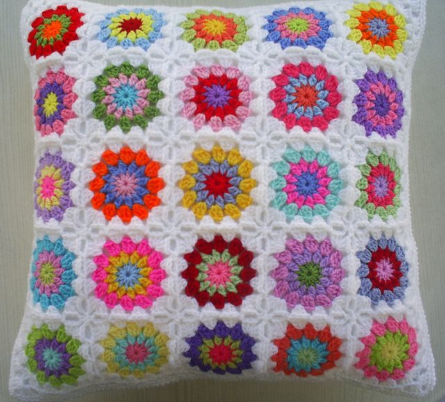 colors in white granny square cushion cover by riavandermeulen, via Flickr