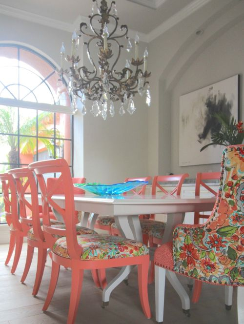 Colorful dining room. Taking a traditional cherry dining room table and chairs from yawn to wow. Painted coral upholstered chairs and gray table.