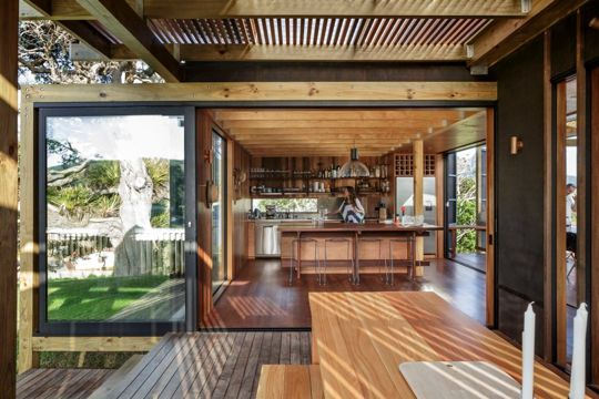 Those New Zealanders do relaxation right. This summer home in Auckland has everything you never knew you needed, including a removable roof!