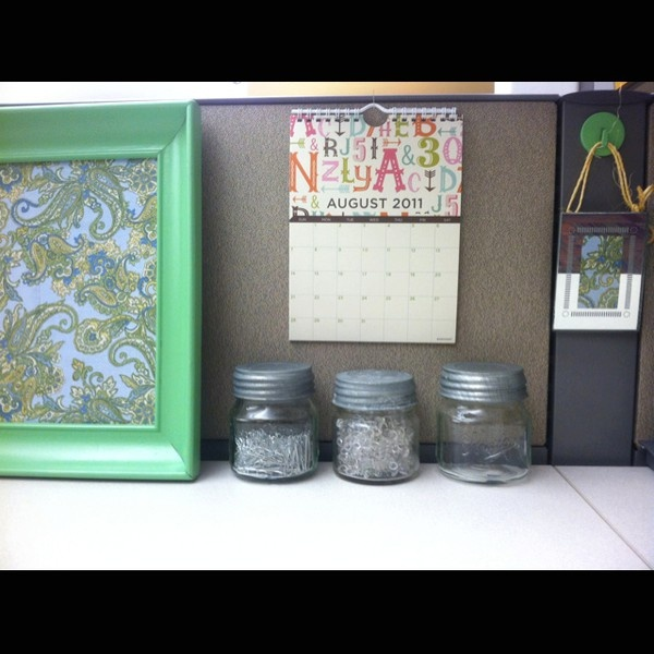 Mission: Cubicle Makeover.  I am SOOOO doing this.  Michaels here I come, I need mason jars at my desk.