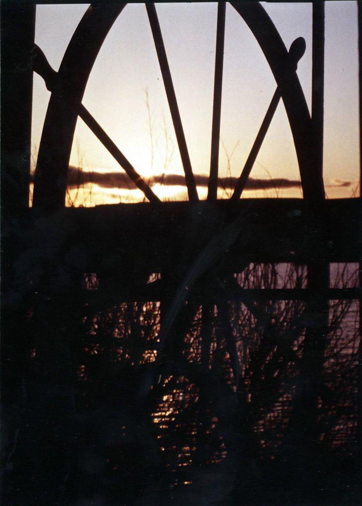 Sunset through the paddlewheel - PS Tarella 1985