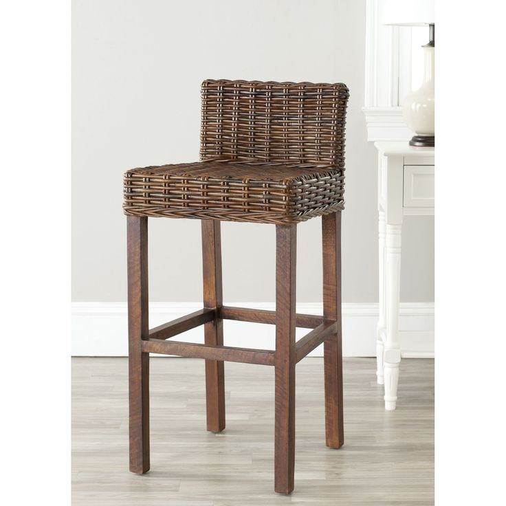 The St. Thomas Collection brings a piece of the resorts to any room with bar stool featuring beautifully woven brown wicker, a sturdy wood frame and a chic design brings a fresh look to any island decor.