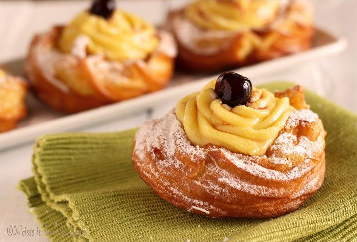 Zeppole alla crema e amarene: un dolce tradizionale per San Giuseppe, ma ottime anche nel periodo di Carnevale. Un dolce morbido e goloso di pasta choux.