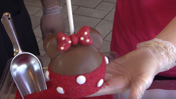Last week we shared a DIY tutorial on how to make the perfect Mickey Mouse character apples from Candy Cauldron at Disney Springs. And we teased that although the Mickey apple is super popular among guests, he surprisingly isn't the #1 character