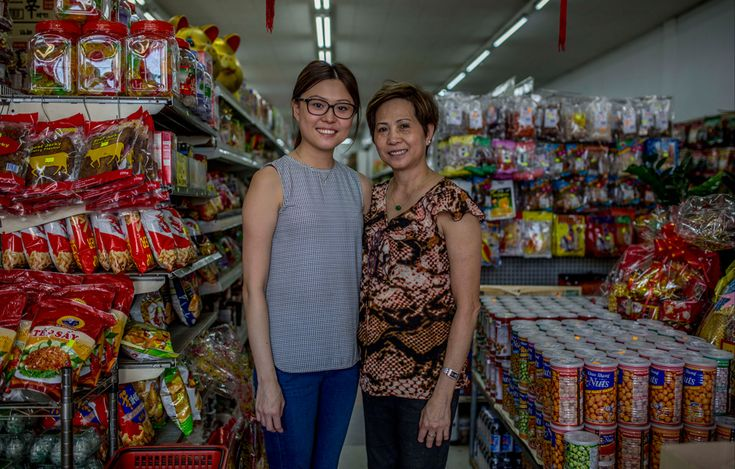 Lisa Vuu and her mother Phuong Dang in their family's Vietnamese grocery store in Footscray, Melbourne