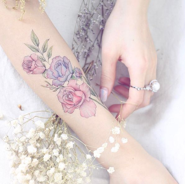 Roses on forearm by Mini Lau